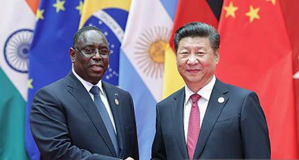 Xi Jinping promet 60 milliards de dollars de plus  à...