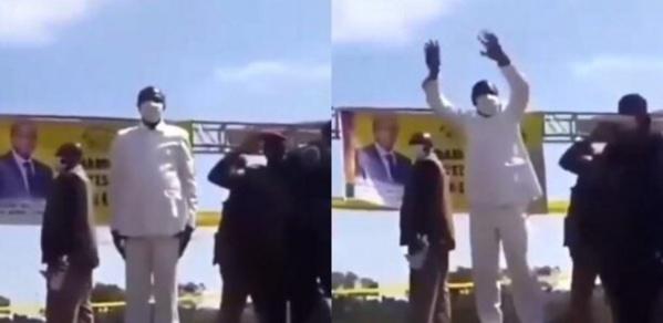 Alpha Condé danse pendant que l'hymne de la Guinée est exécuté